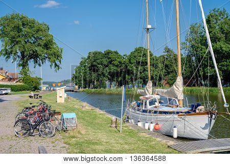 MEM, SWEDEN - JUNE 25, 2016: Leisure boat marina during midsummer in Mem. Mem is the gate to Gota Canal from the Baltic sea on the east coast of Sweden.