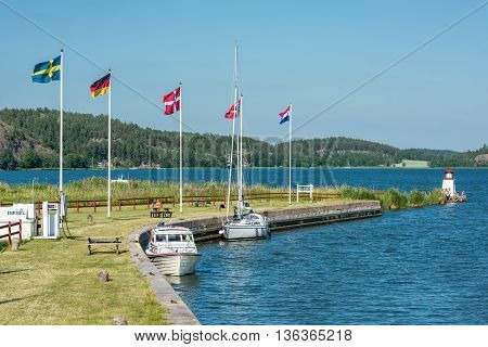 MEM, SWEDEN - JUNE 25, 2016: The Baltic sea and Mem during midsummer  in Sweden. Mem is the gate to Gota Canal from the Baltic sea on the east coast of Sweden.