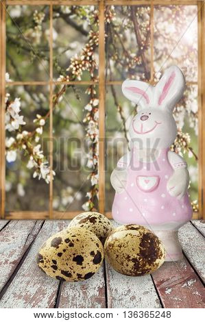 Easter bunny with eggs on the windowsill