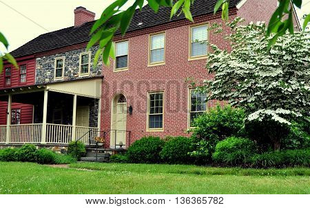 Kennett Square Pennsylvania - June 4 2015: The Woodlands built in 1828 and acquired by the Philiipis Family in 1890 houses a store selling fresh and dried mushrooms along with a gift shop