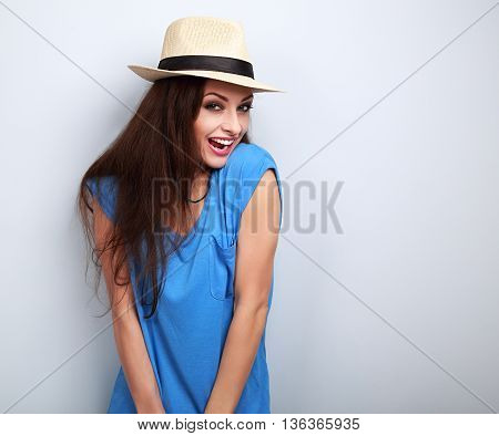 Excited Joying Young Woman In Hat Looking With Open Mouth On Blue Background