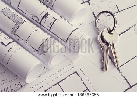 Toned and selective focus image. Bunch of keys on the house plan