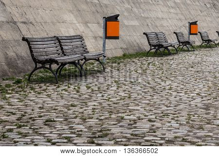 urban furniture - wooden bench and trash cans