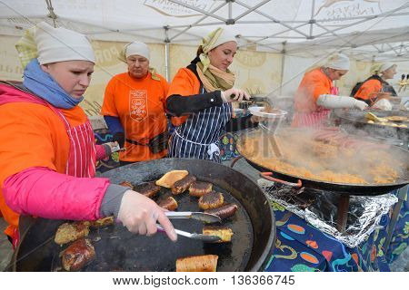 VILNIUS, LITHUANIA - MARCH 7: Unidentified people trade food in annual traditional crafts fair - Kaziuko fair on Mar 7, 2014 in Vilnius, Lithuania
