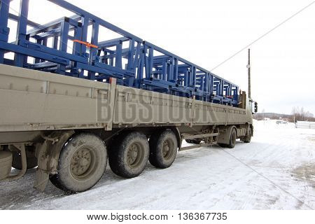truck loaded with metal structures on the industrial site