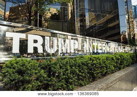 New York, USA - June 18, 2016: A sign of Trump International Hotel in New York City with hotel in the background