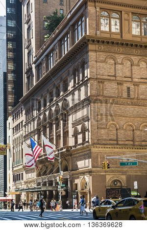 New York, USA - June 18, 2016: Carnegie hall with american flag in New York City