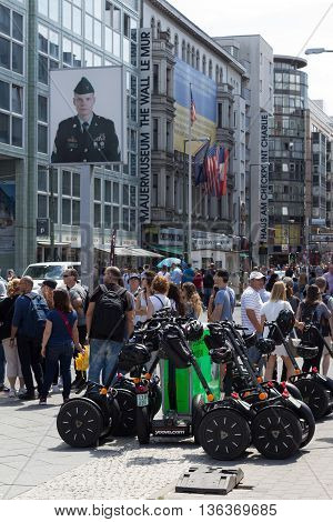 Segway And Tourists At Checkpoint Charlie