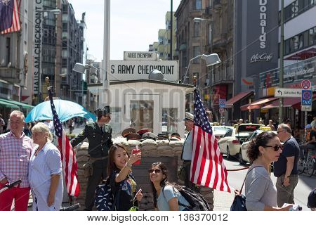 People At Checkpoint Charlie In Berlin