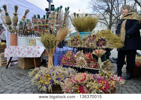 VILNIUS, LITHUANIA - MARCH 8: Unidentified people trade traditional palm bouquets in annual traditional crafts fair - Kaziuko fair on Mar 8, 2014 in Vilnius, Lithuania