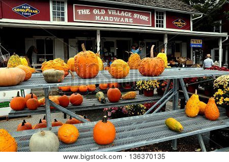 Bird-in-Hand Pennsylvania - October 14 2015: Pumpkins gourds and Chrysanthemums are for sale at the Old Village Hardware Store