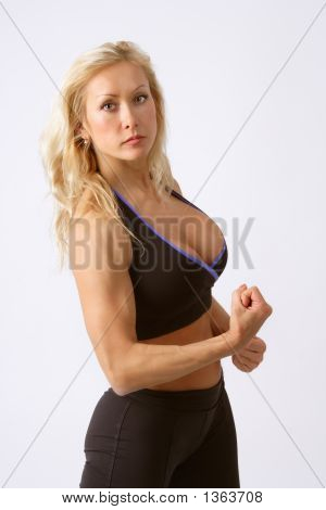 Beautiful Athletic Blonde Girl Showing Her Muscles