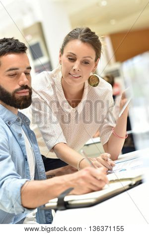 Colleagues in office checking agenda