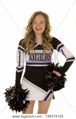 a cheerleader with down syndrome looking to the side with a smile on her face.