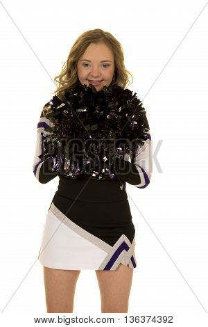A teen cheerleader with a big smile she has down syndrome.