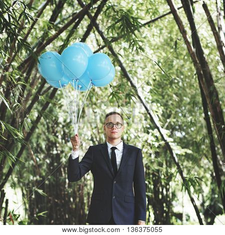 Businessman Holding Balloons Nature Concept