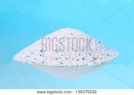 Hill of detergent on a blue background