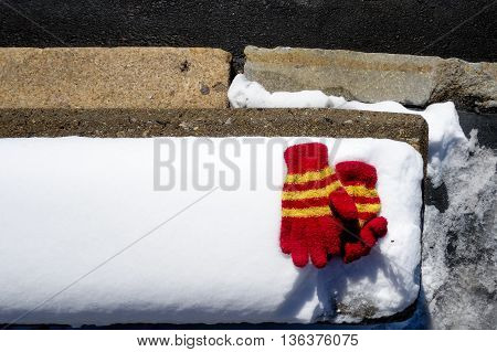 Pair of lost gloves laid out in the snow