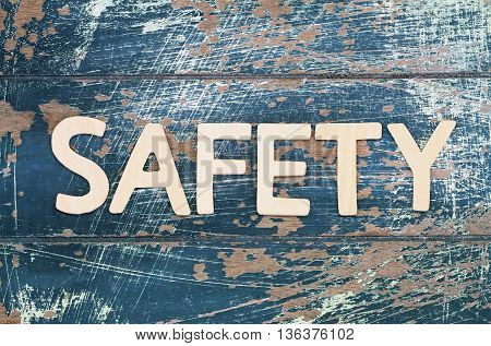 Word safety written on rustic wooden surface