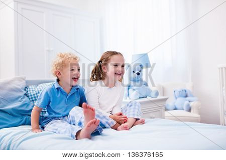 Kids Playing In White Bedroom