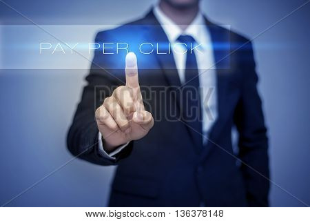 Businessman hand touching PAY PER CLICK button on virtual screen