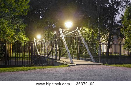 Makarovsky pedestrian bridge across the Petrovsky ravine in Kronstadt at night, Russia Saint-petersburg
