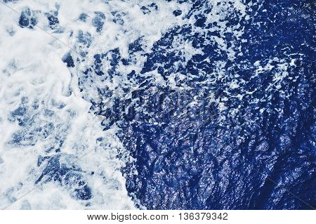 Blue Sea Water Surface In Motion With Foam