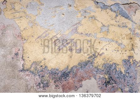 old house wall with cracked plaster. grunge textured background