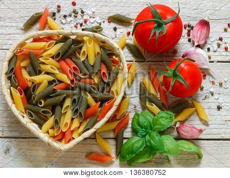 Colorful Italian raw pasta. Pasta penne rigate tricolor