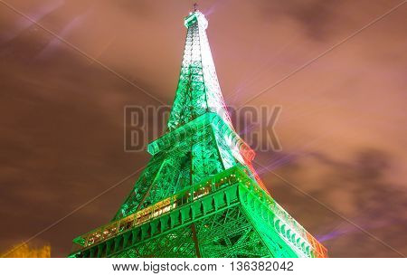 Paris France-June 27 2016: The Eiffel tower lit up in colors of Italy's flag after victory over Spain in soccer Europe championship 2016.