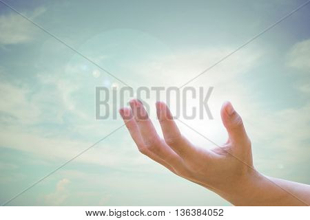 Human hands open up Natural blurred of the background sky.Environment Day concept. Ecology concept.