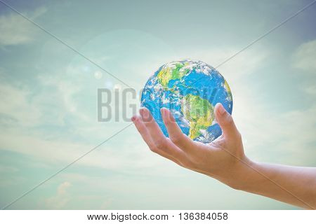 World Human hands the sky in the background blurred.Environment Day concept. Ecology concept. .Environment Day concept. Ecology concept.Elements of this image furnished by NASA.