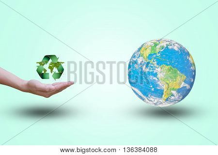 Hands opens up recycle symbol Double exposure green leaves. the world on background pastel color.Environment Day concept.Ecology concept.The power harmonious.Elements of this image furnished by NASA.