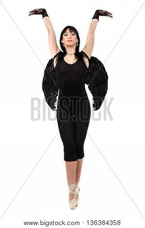 young woman dressed as dark angel dancing, isolated in full body on white background