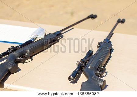Small-bore pneumatic weapon. The small-bore pneumatic weapon on a table. Small-bore air rifle.