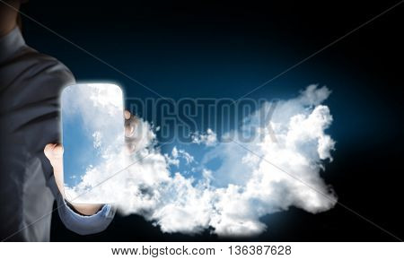 Close view of businesswoman showing smartphone with cloud concept on screen