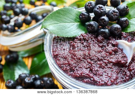 Chokeberry jam and ripe berry of chokeberry