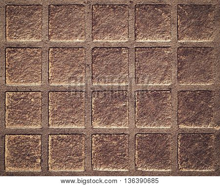 abstract background or texture square pattern on the rusty iron hatch