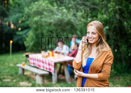 Calling Friends On A Picnic