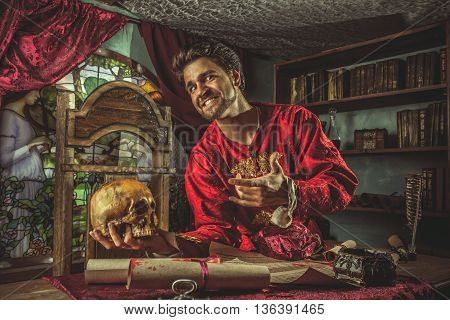 Smiling Medieval Grandee Is Pointing At The Skull In The Hand.