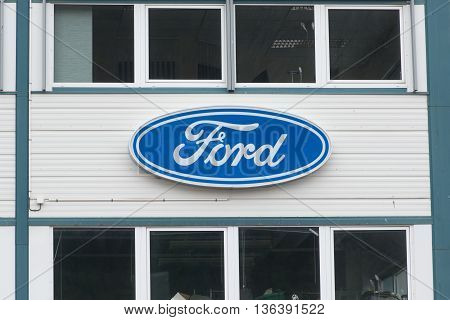 Andalsnes, NORWAY - CIRCA JUNE, 2016: Ford dealer sign at the entrance of the building. The Ford Motor Company is an American multinational automaker founded by Henry Ford in 1903.