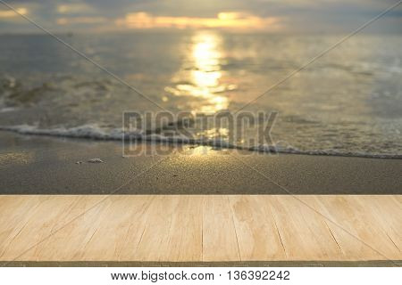 Wood floor with background of sea view at sunset