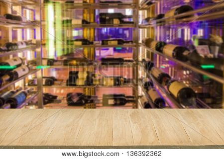 Wood floor with blur of alcohol bar background