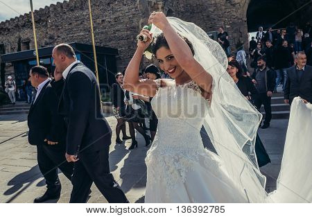 Mtskheta Georgia - April 26 2015. Bride walks in front of Svetitskhoveli Cathedral (english - Cathedral of the Living Pillar) in Mtskheta one of the oldest cities of Georgia