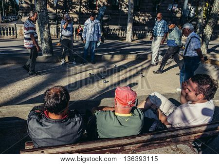 Barcelona Spain - May 22 2015. Men plays boules game at Lluis Companys Promenade in Barcelona