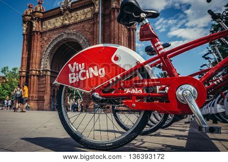 Barcelona Spain - May 23 2015. Viu Bicing share system next to triumphal arch at Lluis Companys Promenade in Barcelona