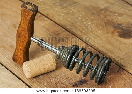 View of vintage corkscrew with wood background
