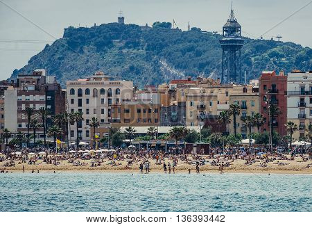 Barcelona Spain - May 24 2015. View of La Barceloneta beach and Montjuic Hill on background