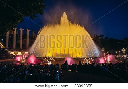 Barcelona Spain - May 24 2015. A crowd of people watches evening show of Magic Fountain in Barcelona