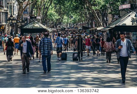 Barcelona Spain - May 26 2015. Tourists and city residents walks at famous La Rambla street